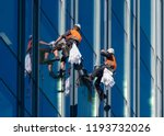 window washers cleaning the... | Shutterstock . vector #1193732026