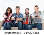 a smiling group of friends sit... | Shutterstock . vector #119374366