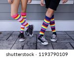 Tween girls legs with  colorful ...