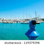 Barcelona port marina with blue telescope and sailboats - stock photo