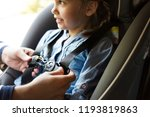 father helping to put on the... | Shutterstock . vector #1193819863