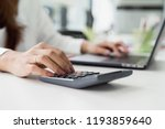 female accountant using... | Shutterstock . vector #1193859640