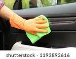 man washing car door from... | Shutterstock . vector #1193892616
