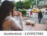 woman sitting in cafe with big... | Shutterstock . vector #1193927983