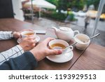 couple sitting in cafe drinking ... | Shutterstock . vector #1193929513