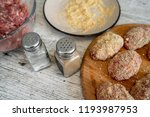prepare chops on a gray... | Shutterstock . vector #1193987953