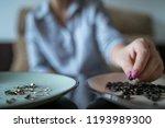 the girl eats the sunflower... | Shutterstock . vector #1193989300