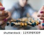 the girl lies near the pills ... | Shutterstock . vector #1193989309