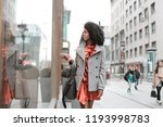 afro woman walking in the city... | Shutterstock . vector #1193998783