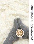 woman feet in warm woolen socks ... | Shutterstock . vector #1194005803