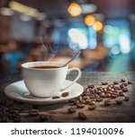 a cup of coffee and coffee... | Shutterstock . vector #1194010096