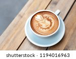 a beautiful cup of cappuccino... | Shutterstock . vector #1194016963
