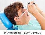 seniorpatient wearing a ... | Shutterstock . vector #1194019573