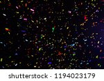 thousands of confetti fired on... | Shutterstock . vector #1194023179