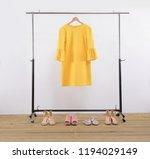 female yellow sundress  vest on ... | Shutterstock . vector #1194029149