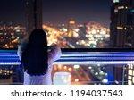 Woman Enjoying With Night City...