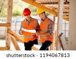 two men dressed in shirts ... | Shutterstock . vector #1194067813