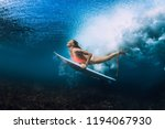 Attractive Surfer Woman Dive...
