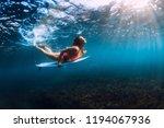 attractive surfer girl dive... | Shutterstock . vector #1194067936