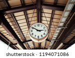 old clock hang on platform in... | Shutterstock . vector #1194071086