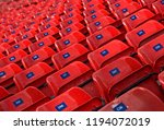 empty rows of red concert seats.... | Shutterstock . vector #1194072019