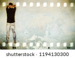scratched wall in film strip... | Shutterstock . vector #1194130300