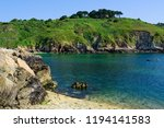 blue water and rugged cliffs in ... | Shutterstock . vector #1194141583
