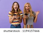 two pretty excited young girls... | Shutterstock . vector #1194157666
