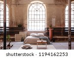 table on rug in spacious bright ... | Shutterstock . vector #1194162253
