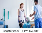 woman with crutches during... | Shutterstock . vector #1194163489