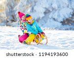 little girl and boy enjoying... | Shutterstock . vector #1194193600