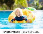 child with inflatable toy ring... | Shutterstock . vector #1194193603