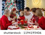 family with children eating... | Shutterstock . vector #1194195406