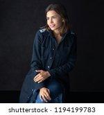 girl in a cloak in a dark studio | Shutterstock . vector #1194199783