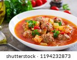 hot stew tomato soup with... | Shutterstock . vector #1194232873