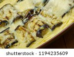 cheesy eggplant casserole with... | Shutterstock . vector #1194235609