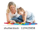 happy mother playing with baby | Shutterstock . vector #119425858