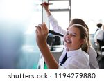 female high school students... | Shutterstock . vector #1194279880