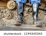 rubber boots for work use. an... | Shutterstock . vector #1194345343