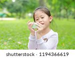 cute little asian child girl... | Shutterstock . vector #1194366619