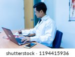 doctor and his table in the... | Shutterstock . vector #1194415936