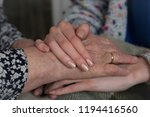 young female hands holding... | Shutterstock . vector #1194416560