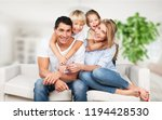 beautiful smiling family... | Shutterstock . vector #1194428530