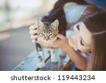 Stock photo young woman with cat outdoors 119443234