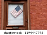 american flag on a door of the... | Shutterstock . vector #1194447793