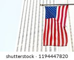 american flag on a building in... | Shutterstock . vector #1194447820