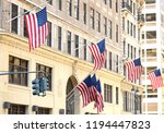 us flags on a building in new... | Shutterstock . vector #1194447823