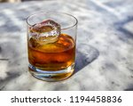 old fashioned cocktail on a bar ...   Shutterstock . vector #1194458836
