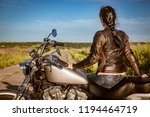 biker girl in a leather jacket... | Shutterstock . vector #1194464719