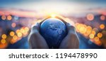 the globe earth in the hands of ... | Shutterstock . vector #1194478990